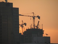 Towering cranes (krismo_pompas) Tags: sunrise construction asia skyscrapers crane bangkok cranes nov2007