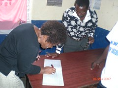 Mama E signs the guestbook in Lunga Lunga