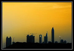 Dubai skyline, Emirates (fatboyke (Luc)) Tags: city sunset sky building tower monument colors skyline skyscraper canon effects design construction dubai cityscape desert crane uae middleeast july icon structure spotlight cranes developer zayed manmade underconstruction unitedarabemirates breathtaking jewel global 2007 sheikhzayedroad highrisebuilding abendstimmung playingwithcolors blueribbonwinner emiratesofficetower supershot chelseatower mywinners eos400d industrialscene rosetower aplusphoto superbmasterpiece platinumheartaward newdowntown dohastreet