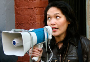 MLA Jenny Kwan addresses a demonstration at the Dominion