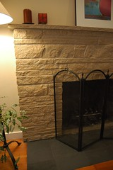 After detail of painted stone fireplace and ne...