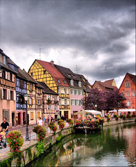 Colmar and clouds (! .  Angela Lobefaro . !) Tags: trip travel flowers trees vacation portrait dog chien france flower macro tree nature water girl leaves architecture clouds reflections landscape canal interestingness bravo europe action streetlamp quality patterns 2006 colmar explore hund cielo alsace nubes nuages frontpage idyllic allrightsreserved lampione explored i500 cesvi natuzzi holidaysvacanzeurlaub angiereal infinestyle maxgreco angelalobefaro angelamlobefaro alonsodrsinterview fachhaus fachhuser wwwcesviorg angelamarialobefaro massimilianogreco allrightsreservedclouds