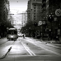 end of market (Super G) Tags: sanfrancisco street blackandwhite bw man silhouette square market trolley tracks pedestrian embarcadero bayarea streetcar financial soe decisive fline marketst maninthestreet fmarket electricvehicle andtwobirds no1051 mywinners diamondclassphotographer flickrdiamond takenfromthefootofmarketst chinatownandfinancialdistrict