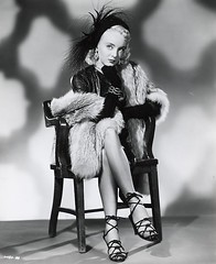 Carolyn Jones (Silver Screen Sirens) Tags: classic beauty hat vintage fur chair antique sandals feathers gloves sit blonde actress sultry earrings dynamite elegant silverscreen adamsfamily morticiaadams carolynjones