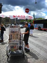 Newspaper Bike (Mikael Colville-Andersen) Tags: bike bicycle umbrella copenhagen nyhavn newspaper parasol vendor sell nytorv cargobike kongens cyclelogistics