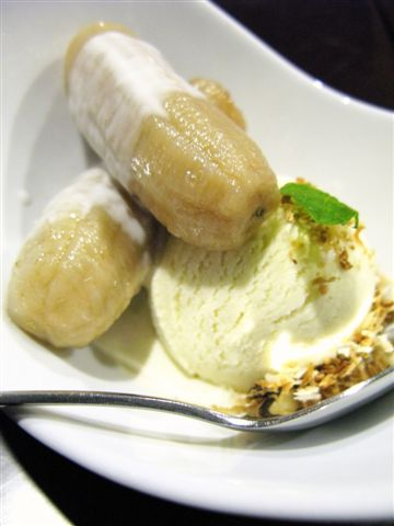 Bananas in palm sugar syrup and coconut ice cream