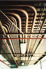 Tubes (R.A.Jimnez) Tags: red white 35mm crossprocessed tubes cream poles olympusxa2 walgreens connection fujicolorsensia400isoslidefilm