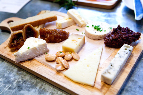 Cheese board with Marcona almonds, dried figs, olive paste and fig paste