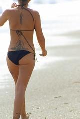 beach criature (ellinuxero) Tags: espaa woman sexy beach girl tattoo pentax playa almeria aguadulce apain k10d pentaxk10d smcpm300mmf40