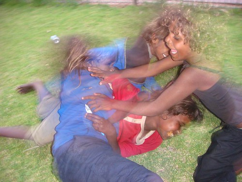 Aboriginal kids playing around, showing off...Alice Springs, 2007.