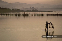 Net at the ready (wprasek) Tags: sunset people brown lake fish net nature water ecology monochrome contrast work river dark person evening bay twilight fishing scenery mesh dusk labor traditional working monochromatic greece human labour ready catch environment inlet gr backlit woven outline laborer corfu hardwork environmentalism humanbeing humans waterway ecosystem labourer manuallabour humanbeings manuallabor singlecolor singlecolour backbreaking kanoni folioworkinglife warrenprasek chalkiopouloulagoon xoodu wprasek wwwxooducom wwwwprasekcom