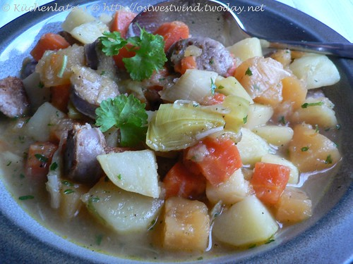 Stew of winter vegetables with fried sausage and parsley
