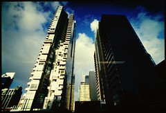 this city will squash you #2 (mugley) Tags: city urban architecture clouds buildings reflections nikon fuji skyscrapers australia melbourne slide victoria lookup dirt e6 hairs qv1 qv specks f801s polariser sensia100 tokina17mmf35atx cityskip grottyslide wardletower bhpbillitonhq