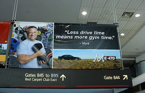 Toll Road Coverboy - E-470 Advert, Denver International Airport