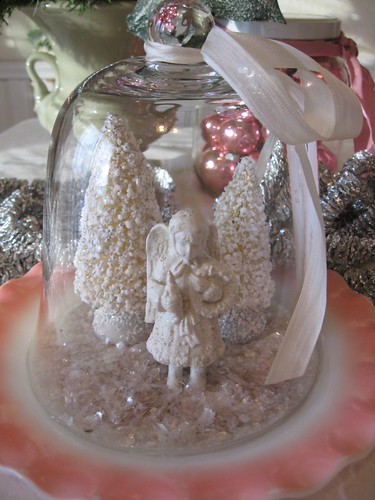 angel and snow under glass