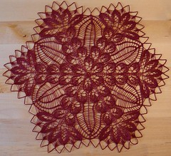 red silk doily