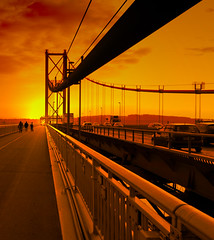 Forth road bridge as the sun goes down (Semi-detached) Tags: road bridge sunset people sunlight cars walking coast scotland crossing motorway suspension south north perspective structure forth cables toll february 2008 firth queensferry lorries betterthangood