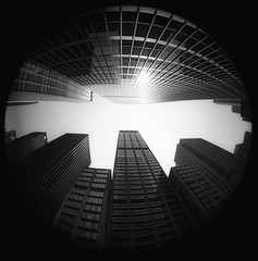NY Skyscrapers (fisheye view) (crowt59) Tags: new york bw white ny black skyscraper nikon manhattan fisheye 8008s intrigued eyewashdesign 123bw crowt59 clevercreativecaptures