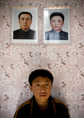 Under the portraits of the beloved leaders - North Korea  (Eric Lafforgue) Tags: pictures travel house portraits photo kid war asia child picture korea kimjongil asie coree journalist journalists northkorea  dprk coreadelnorte juche kimilsung nordkorea lafforgue   ericlafforgue   coredunord coreadelnord  northcorea coreedunord rdpc  insidenorthkorea  rpdc   coriadonorte  kimjongun coreiadonorte