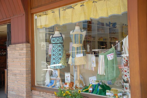 the emmeline apron in the store front of fabrics on mill street