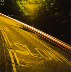 Slow (but also fast) (Lady Vervaine) Tags: road street city uk longexposure trees light england urban motion tree green london cars lines car yellow night speed warning dark streetlight glow slow darkness bend britain text trails fast line trail alexandrapalace advice glowing lighttrails curve marking sodium paradox paradoxical doubleyellowlines yellowlines ignored speedtrails artlegacy