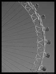 On the Outside (shutterBRI) Tags: uk travel england blackandwhite bw london monochrome canon photography photo arch ride unitedkingdom powershot ferriswheel 2007 a630 shutterbri challengeyouwinner brianutesch photofaceoffwinner pfogold brianuteschphotography