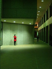 Red Jacket (historygradguy (jobhunting)) Tags: light red people woman building college girl boston architecture night standing campus ma concrete person bc candid massachusetts columns newengland jacket thumbsup mass bostoncollege bigmomma superhearts platinumheartaward thumbsupwinner 100commentgroup