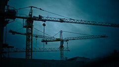 Deep blue: Cranes (manganite) Tags: blue sky color berlin colors architecture clouds digital buildings germany dark geotagged interestingness nikon colorful europe tl perspective silhouettes cranes explore onecolor d200 nikkor dslr toned mitte vignette thecolorblue 50mmf18 blueribbonwinner interestingness417 i500 utatafeature manganite nikonstunninggallery abigfave date:year=2007 geo:lat=52513309 geo:lon=13397033 date:month=september date:day=30 format:ratio=169