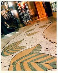 "a beautiful mosaic floor that I laid, for Bigsby & Kruthers ""last gasp"" store on Chicago's Mag Mile. (Man_of Steel) Tags: chicago broken tile floor mosaic mosaico gaudi organic leafs diseño brokentile estilliodegaudi trencandis michiganandohio bigsbykruthers michiganavenueatohiostreet bigsbyandkrutherslonggonestoremichiganohio goldpaviomentotile installationsthatnowlongerexist chicagosmichiganavenuestore votedstorefotheyearawardbynationalretailingmagazine goldbizzazzatile goldglasstiles"