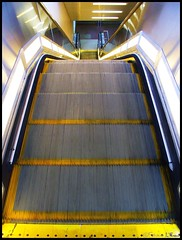 Up or Down? - 133/365+1 - 05/12/08 (Harpo42) Tags: up yellow silver shiny escalator steps nj vertigo down trainstation dizzy 2008 patco southjersey lighted collingswood may12 treads camdencounty publictrasit project366 drpa 1333651