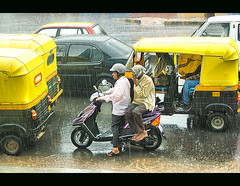 Monsoon - Some enjoy from shade,others suffer in open with bare foot :( (@k@sh) Tags: rain canon garden 350d scout read barefeet 1855mm pp akash udipi rainrainrain btm aaw explored xplore activeassignmentweekly may2008 aplusphoto rainshot excellentphotographerawards goodoldkitlens thanksgodkitlens udipigarden ppaug08 ppjun09
