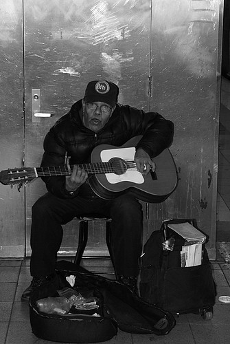 Frank singing/whistling and playing guitar at 59th street