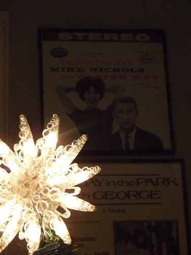The star on top of the tree along with inspiration on the wall