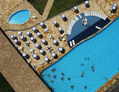 KAP of a hotel pool in Beberibe, CE, Brazil - 03 (Ric e Ette) Tags: blue summer brazil vacation people white holiday water pool gua branco azul brasil umbrella hotel chair pessoas exercise chairs cyan frias piscina sunbath sunshade parasol cear vero kap exercises cadeiras sunbathing sunbathers kiteaerialphotography feriado ce cadeira ciano  coliseumhotel beberibe guardasol sombrinha exerccios exerccio bronzeado  guardasis banhodesol bronzeando bronzeamento fotografiaareacompipa  11mp hotelcoliseum gettyimagesbrasil