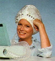 Lighten your hair with a dryer (incurlers) Tags: hair 1960s 1970s beautyshop hairdressing hairdryers curlers hairstyling hairrollers rollersets wetsetswetsets