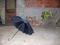 Was Mary Poppins here? (Rosmarie Wirz) Tags: italy fairytale magic fantasy brickwall marypoppins surrealistic blackumbrella abandonedroom objecttrouve justabouttakingoff