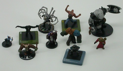 Three Dreamblade minis; three Mage Knight minis, of which two have been removed from their bases and one has been removed from the clicky part of its base; a Heroclix mini; Small, Medium, and Large D&D minis