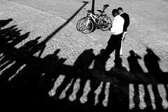 . (ngravity) Tags: street bw men canon blackwhite shadows sweden stockholm candid streetphotography clothes bicycles gamlastan nocrop eos50d makrygiannakis
