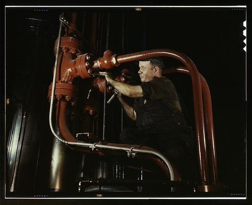 Maintenance man at the Combustion Engineering Co. working at the largest cold steel hydraulic press in the world,  Chattan...