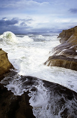 It's Nature's stage at Cape Kiwanda (Zeb Andrews) Tags: ocean storm film beach water oregon 35mm landscape coast waves cliffs pacificocean pacificnorthwest surge nikonfm2 pacificcity capekiwanda fujivelvia50 bluemooncamera zebandrews closeenoughtogetwet zebandrewsphotography