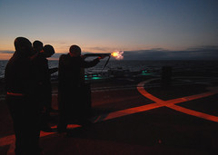 Sailors conduct a low-light, live-fire exercise with a 12-gauge shotgun aboard USS Boone (Official U.S. Navy Imagery) Tags: training lowlight navy sailors sailor usnavy weapons 12gaugeshotgun livefire guidedmissilefrigate ussbooneffg28