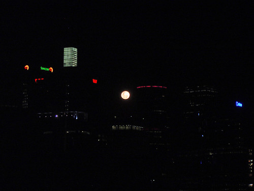 moon rising between the buildings