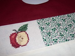 Detail (Fox & Feathers) Tags: baby apple crossstitch bib patchwork spinningpretty
