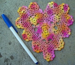 Magenta and yellow doily