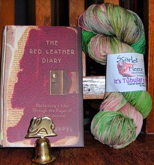 bunny bell, yarn, and Red Leather Diary