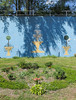 We cannot afford a fountain! (Tim Kiser) Tags: 2014 20140907 allencounty allencountyindiana fortwayne fortwayneindiana grandstreet hoaglandmasterson hoaglandmastersonneighborhood img4851 indiana september september2014 southcalhounstreet art artwork flowergarden flowerbed flowers fountain fountainillustration fountainmural lightblue lightbluepaint lightbluewall metalrailing mowed mowedarea mowedgrass mural northindiana northeastindiana northeasternindiana northernindiana ornamentalplants railbridgeabutment railing spheres sphericaltopiary topiary topiaryillustration unitedstates