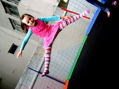 Jump, kid! JUMP! (Honey Pie!) Tags: colors socks cores children jump stripes colores criana pulo meias listras highsocks kneehighsocks pulando ldico ludic listradas meiaslistradas bodylanguag stripessocks cybershotdscs650 stripeslegs pernaslistradas