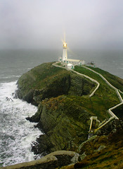 The South Stack, Anglesey (BigBean) Tags: uk winter light sea lighthouse cold water rain wales clouds grey glow wind gale spray fare holyisland leuchtturm anglesey holyhead southstack abbean explore5onthursdaymarch132008