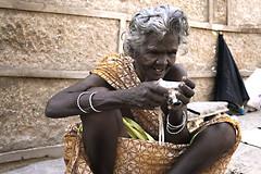 Old grani watching her photo in Nikon Coolpix L5.... :) (Madhu pasulla) Tags: india beggar 1855mm templecity andhrapradesh lookingintocamera chittoor canon400d srikalahasti pasulla madhupasulla