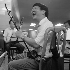 Underpass musician (ndnbrunei) Tags: china blackandwhite bw 120 6x6 tlr musicians rollei mediumformat square hongkong kodak bn mf kodakbw400cn newterritories taipo rolleicord bw400cn classicblackwhite rolleigallery ndnbrunei